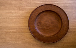 Empty round wooden plate on wood table background, food display Stock Photo