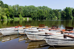 Empty row boats at a lake Stock Photography