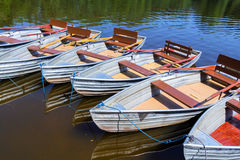 Empty row boats at a lake Stock Photos