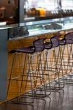 Empty row of stools at a bar Royalty Free Stock Image