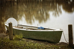 Empty rowboat on lake Chiemsee in autumn Stock Images