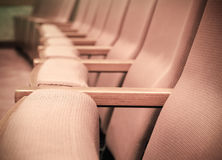 Empty rows of armchairs in hall Stock Photo