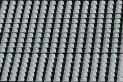 Empty rows of gray stadium seats Stock Photos