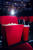 Empty rows of red seats with pop corn and drink Stock Photography