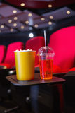 Empty rows of red seats with pop corn and drink on the floor Royalty Free Stock Image
