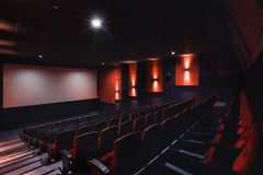 Empty rows of red theater or movie seats. Chairs in cinema hall. Comfortable armchair Royalty Free Stock Photos