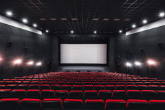Empty rows of red theater or movie seats. Chairs in cinema hall. Comfortable armchair Stock Images