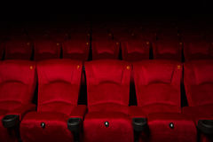 Empty rows of red theater or movie seats Stock Photo
