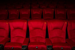 Empty rows of red theater or movie seats. Stock Images