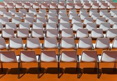 Empty rows of seats backs to spectator Stock Image