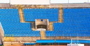 Empty rows of seats at football stadium Stock Photos