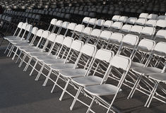 Empty rows of white chairs Royalty Free Stock Photo