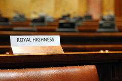 Empty Royal Highness seat in conference hall Royalty Free Stock Photos
