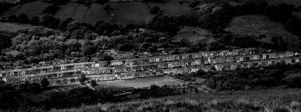 Empty Rugby Pitch. Three terraced streets of housing and a Rugby Football pitch in the former mining village of Llwyncelyn, Porth, Rhondda, Wales Stock Photo