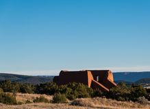 Empty ruins of an old adobe Spanish mission church at Pecos National Historic Park, New Mexico stock images