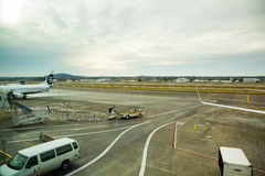 Empty Runway at PDX. Portland, Oregon, USA - January 27, 2014: The tarmac runway sits empty at the Portland International Airport on an overcast day Royalty Free Stock Photos