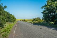 Empty rural asphalt road Royalty Free Stock Image