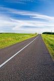 Empty rural road Stock Photos