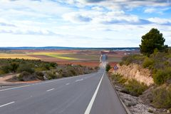 Empty rural road in Central Spain Royalty Free Stock Photography