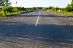Empty rural road go away to distance Royalty Free Stock Images