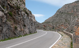 Empty rural road passing via a beautiful  gorge Royalty Free Stock Images