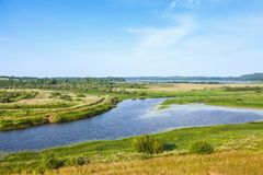 Empty rural Russian landscape. Sorot river. Under blue cloudy sky in the summer day Stock Photography