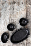 Empty Rustic Black Plates over Grunge Timber Top View Royalty Free Stock Photo