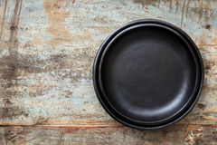 Empty Rustic Black Plates over Grunge Timber Top View Stock Photo