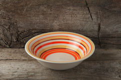 Empty rustic ceramic soup plate Stock Photography