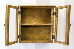 Empty rustic wall mounted display cabinet, horizontal. Royalty Free Stock Image