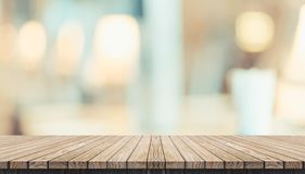 Empty rustic wood plank table and blurred soft light table in restaurant with bokeh background. product display template.Business royalty free stock photo