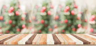 Empty rustic wood plank table top with abstract blur christmas t royalty free stock photo