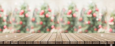 Empty rustic wood plank table top with abstract blur christmas t stock photos