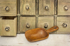 Empty rustic wooden scoop Stock Images