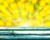 Empty rustic wooden table with abstract summer background Stock Image