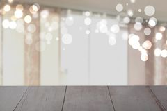 Empty rustic wooden table in front of blurred curtain window bokeh background. Template for your product display montage. Space. stock photo