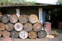Empty rusting barrels royalty free stock image