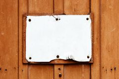 Empty vintage rustic rusty cracked and grungy white signboard in rectangular shape weathered under the elements royalty free stock photo