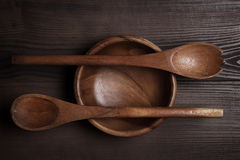 Empty salad bowl and two spoons Stock Images