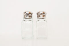 Empty salt and pepper shakers on a white background Royalty Free Stock Photo