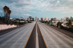 Empty San Diego Freeway with Sunset Sky - Horizontal. Horizontal landscape view of San Diego, California, USA Skyline with empty freeway in foreground. The 5 stock photo