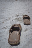 Empty sandals on the beach Stock Photo