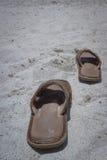 Empty sandals on the beach Stock Photo