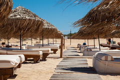 Empty sandy beach and beach beds Stock Image