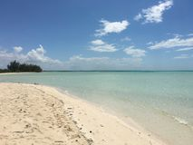 Empty sandy beach, Cuba. Empty sandy beach along blue waters in Cuba on sunny day Stock Image