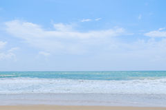 Empty sandy beach with sea under blue sky Royalty Free Stock Photos
