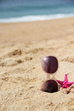 Empty sandy beach and sunglasses Royalty Free Stock Images