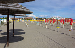 Empty Sandy Beach. With a town in the background Royalty Free Stock Images