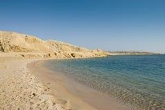 Empty sandy beach in a tropical lagoon. Royalty Free Stock Photos