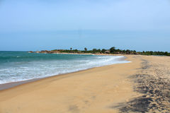 Empty sandy beach washed by the ocean Royalty Free Stock Photography